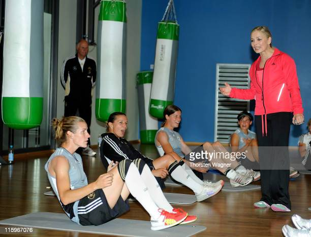 Former wolrd boxing champion Regina Halmich gives instructions during a Germany training session at Fitness First club on June 13 2011 in Frankfurt...