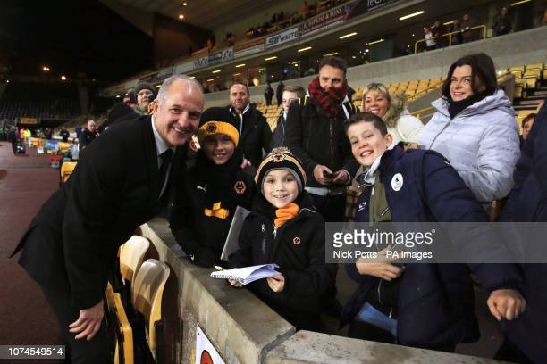 Former Wolverhampton Wanderers player Steve Bull poses for a picture with fans before the Premier League match at Molineux Wolverhampton