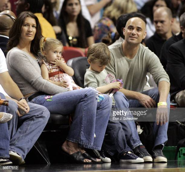 Former women's tennis star Steffi Graf and her husband men's tennis star Andre Agassi and their children watch the Sacramento Kings take on the Miami...
