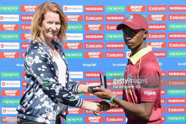 Former Women's World Cup winner Katrina Keenan of New Zealand presents the man of the match award to Alick Athanaze of the West Indies during the ICC...