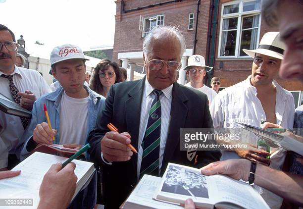 Former Worcestershire and England batsman Basil D'Oliveira signing autographs behind the pavilion during the 1st Test match between England and South...