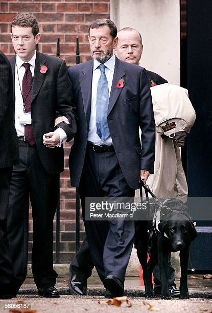 Former Work and Pensions Secretary David Blunkett leaves Downing Street by the back door after a meeting with Pime Minister Tony Blair on November 2...
