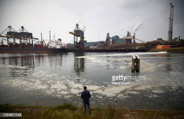 Former worker of the Tata Steel plant is fishing on the North Sea canal as the plant rejects waste on August 21, 2021 in Ijmuiden. The Tata steel...
