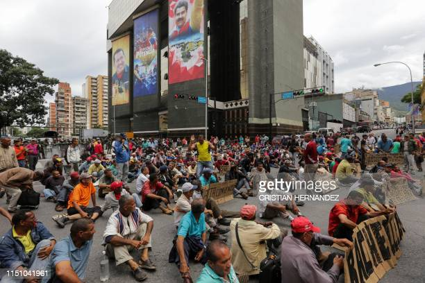 Former workers of the oil sector some of who are holding a hunger strike since May 30 of unpaid labour liabilities demonstrate demanding a meeting...