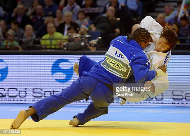 Former World champion Audrey Tcheumeo of France throws Zhehui Zhang of China for ippon to win the u78kg bronze medal during the Dusseldorf Grand Prix...