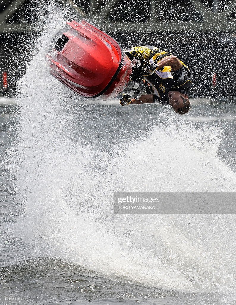 Former world champion Masao Fujisawa performs on his Jet Ski performs as an exhibition to attract people to visit Asakusa shopping and amusement district at the Sumida River Festival in Tokyo on June 6, 2010. AFP PHOTO/Toru YAMANAKA