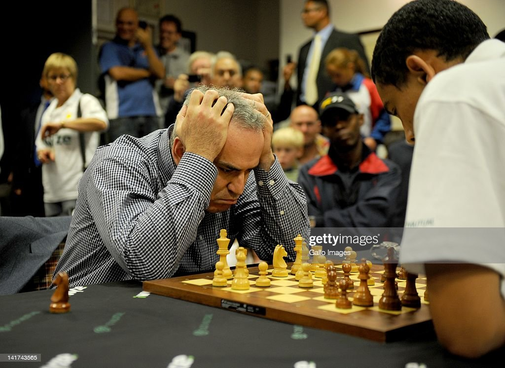 Former World Chess Champion Garry Kasparov (L) plays a game of chess against South African champion Marcil Roberts on March 22, 2012 in Cape Town, South Africa. Kasparov is in the country as the guest of local chess education project Moves for Life (MFL). A branch of the Kasparov Chess Foundation (KCF) has been established in South Africa with the objective of taking the successful MFL chess initiative into other African countries.