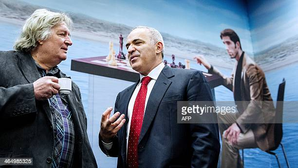 Former World Chess Champion Garry Kasparov speaks with Dutch chess player Jan Timman during a visit of the Tata Steel Chess Tournament in Wijk aan...
