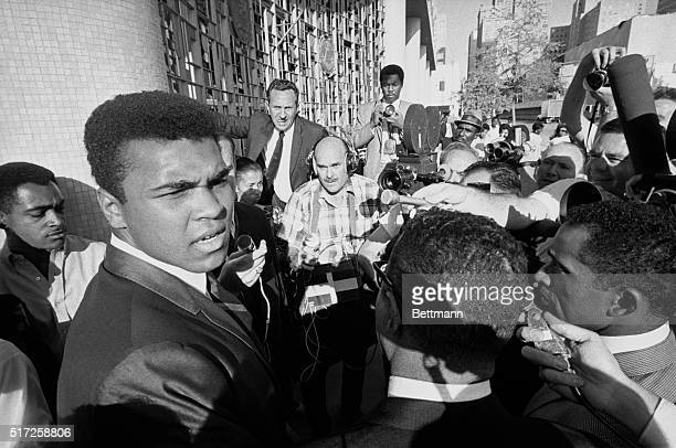 Former world heavyweight boxing champion Muhammad Ali is surrounded by journalists as he leaves the federal court after a jury found him guilty on...