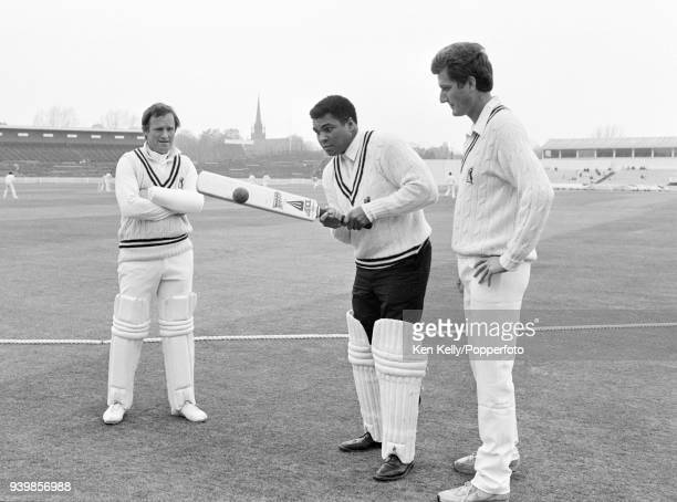 Former world heavyweight boxing champion Muhammad Ali receives instruction in batting techniques from Warwickshire's Dennis Amiss and Bob Willis...