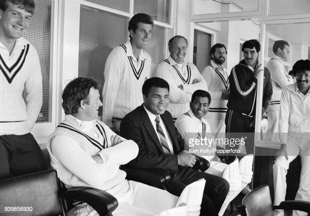 Former world heavyweight boxing champion Muhammad Ali watches the Britannic Assurance County Championship match between Warwickshire and Surrey with...