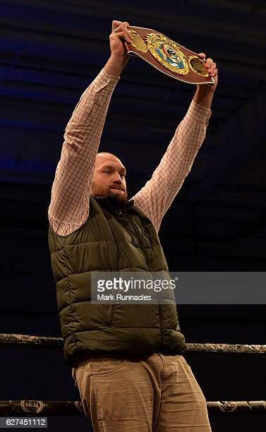 Former World Heavyweight Boxing Champion Tyson Fury holds up Billy Joe Saunders belt as he takes on Artur Akavov of Russia during the defence of his...