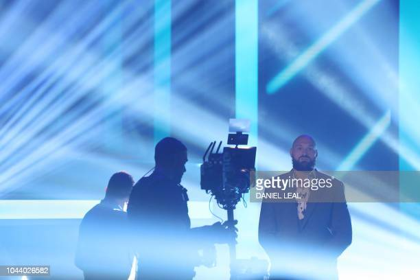 Former world heavyweight champion British boxer Tyson Fury is seen ahead of a press conference in London on October 1 2018 to promote his scheduled...