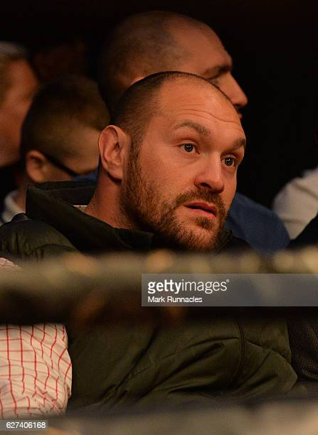 Former World HeavyWeight Champion Tyson Fury looks on from ringside ahead of the WBO Middleweight title fight between Billy Joe Saunders of England...