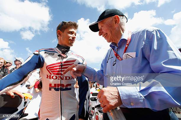 Former World Motorcycle Champions Casey Stoner and John Surtees talking at Goodwood on June 27 2015 in Chichester England