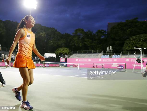 Former world No 4 tennis player Kimiko Date of Japan leaves the court after completing her retirement ceremony at Ariake Tennis Forest Park in Tokyo...