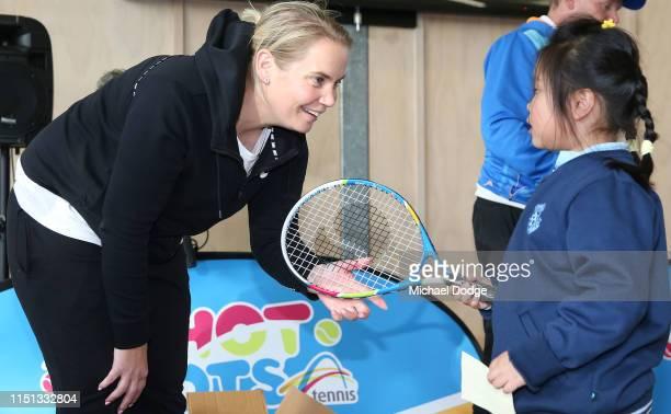 Former world No.4 tennis player, Jelena Dokic of Australia hands out racquets to students from St Joseph's Catholic Primary School in Springvale...