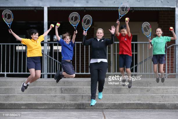 Former world No.4 tennis player, Jelena Dokic of Australia, jumps with students from St Joseph's Catholic Primary School in Springvale during the...