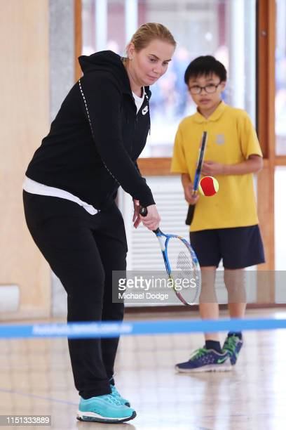 Former world No.4 tennis player, Jelena Dokic of Australia, teaches tennis to students from St Joseph's Catholic Primary School in Springvale during...