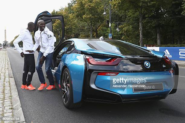 Former world record holder Wilson Kipsang of Kenya and Emmanuel Mutai of Kenya drive a BMW i8 at the Siegessaeule on September 23 2016 in Berlin...