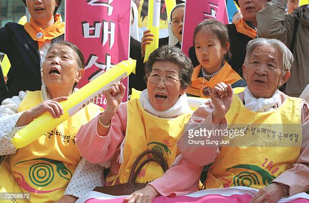 Former World War II South Korean comfort women shout slogans in front of the Japanese Embassy March 13 2002 during the 500th weekly antiJapan rally...