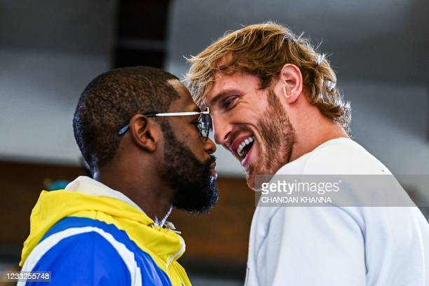 Former world welterweight king Floyd Mayweather and YouTube personality Logan Paul face-off during the media availability ahead of their June 6...