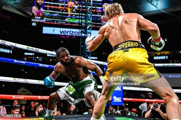 Former world welterweight king Floyd Mayweather and YouTube personality Logan Paul fight in an eight-round exhibition bout at Hard Rock Stadium in...