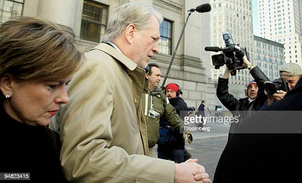 Former WorldCom Inc CEO Bernard Ebbers and his wife Kristie are surrounded by members of the media after they leave Manhattan Federal Court Tuesday...