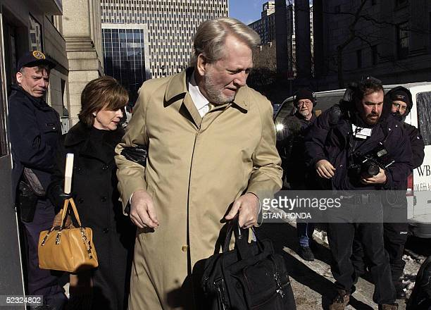 Former WorldCom Inc CEO Bernard Ebbers and his wife Kristie look at a photographer who fell as they arrived at federal court 09 March 2005 in New...