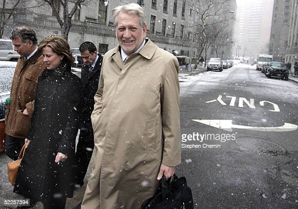 Former WorldCom Inc Chief Executive Bernard Ebbers leaves federal court with his wife Kristie and his legal team February 28 2005 in New York City...
