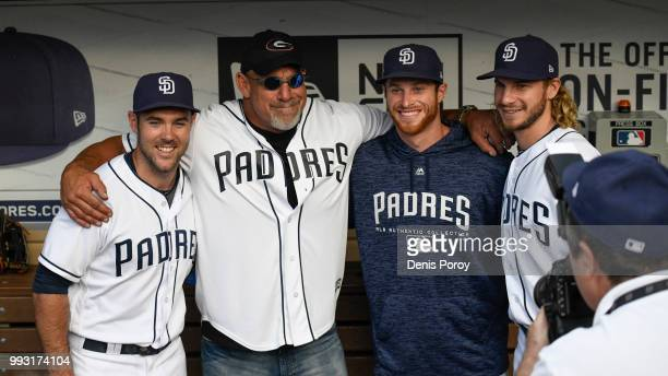 Former wrestler Bill Goldberg poses with San Diego Padres players before throwing out the first pitch before a baseball game between the San Diego...