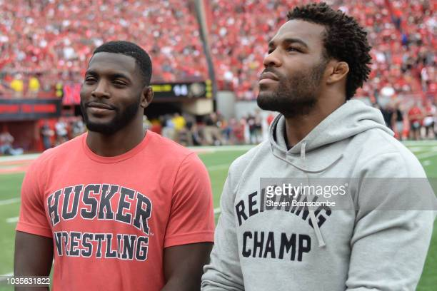 Former wrestlers James Green of the Nebraska Cornhuskers and Jordan Burroughs are honored during the game against the Colorado Buffaloes at Memorial...