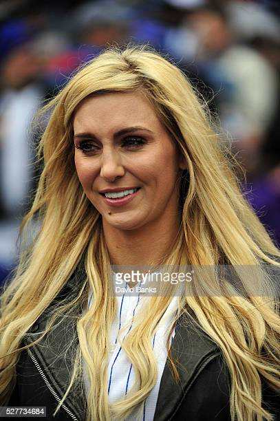Former WWE women's champion Charlotte Flair gets ready to throw out the ceremonial first pitch before the game between the Chicago Cubs and the...