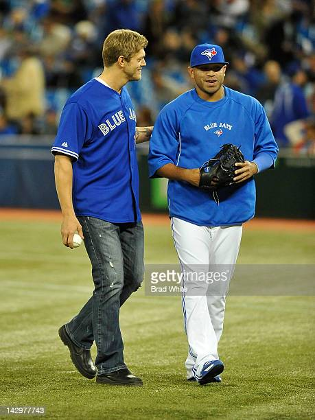 Former WWE wrestler Edge takes part in an on field ceremony with Ricky Romero of the Toronto Blue Jays prior to MLB game action against the Baltimore...