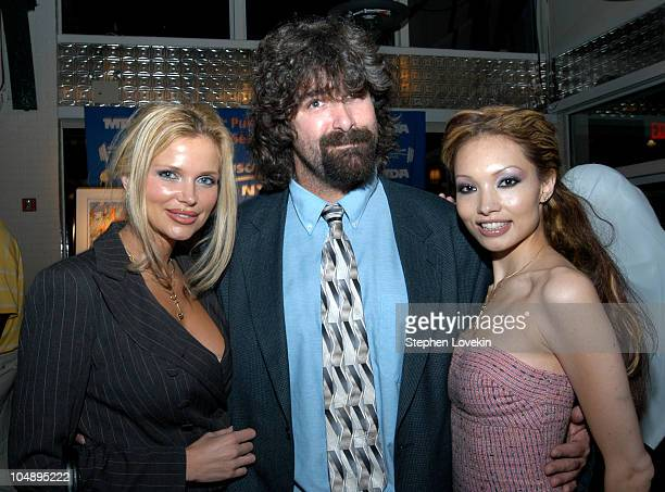 Former WWF Champion Mick Foley with Penthouse pets Victoria Zdrok and Linn Thomas