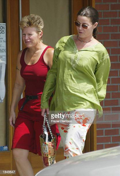 Former WWF wrestling star Chyna Joanie Laurer walks with an unidentified friend on August 16 2002 in Beverly Hills California