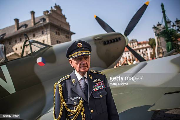 Former WWII spitfire RAF pilot Emil Bocek aged 92 poses for photographers infront of a Mk IX spitfire replica after the ceremony commemorating the...