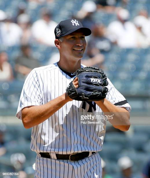 Former Yankees player Andy Pettitte smiles before throwing a pitch in the Old Timers game during New York Yankees Old Timers Day festivities before...