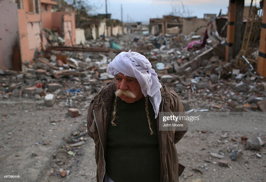 Former Yazidi resident Khalaf Halti, 62, walks through the rubble of his neighborhood on November 15, 2015 in Sinjar, Iraq. Kurdish forces, with the aid of massive U.S.-led coalition airstrikes, liberated the town from ISIL extremists, known in Arabic as Daesh, in recent days. Although many minority Yazidis celebrated the victory, their home city of Sinjar lay in almost complete ruins. Yazidi fighters and some former residents have been taking any salvagable items out of the rubble, the town being uninhabitable and perilously close to the frontline.