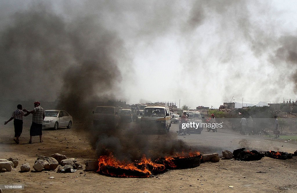 Former Yemeni soldiers block a road in Radfan in the Yemeni Lahj province, 370 kms south of Sanaa, on June 5, 2010 with burning tires in protest against the government's decision to stop paying their salaries. Many of the soldiers protesting had taken part in the six-month battles against Shiite Huthi rebels in northern Yemen.