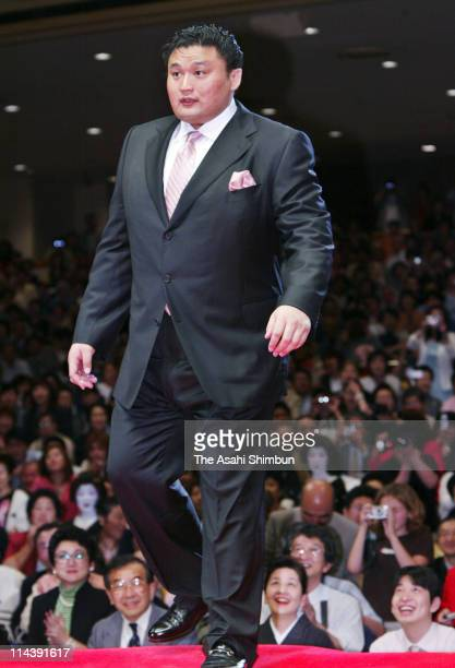Former yokozuna Takanohana whose real name is Koji Hanada stands during the topknot cutting ceremony at Ryogoku Kokugikan on June 1 2003 in Tokyo...
