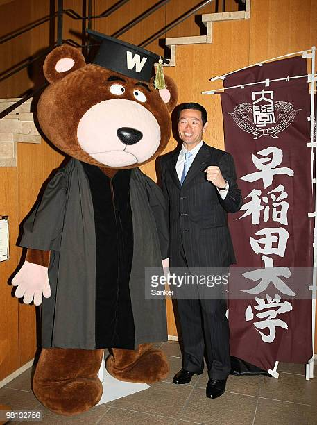 Former Yomiuri Giants and Pittsburgh Pirates pitcher Masumi Kuwata poses for photographs after attending the commencement ceremony of Waseda...