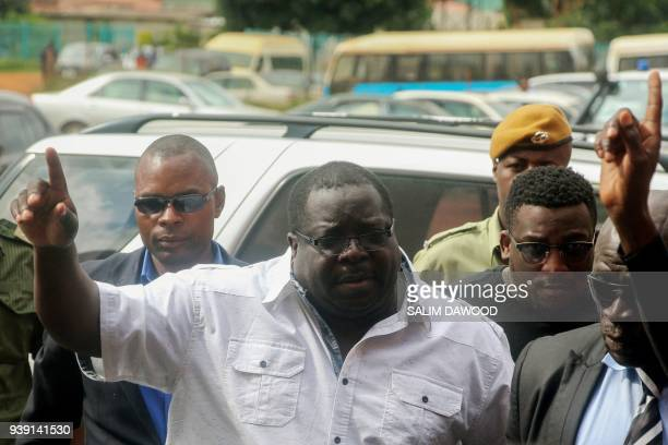 Former Zambian minister and a leading critic of President Edgar Lungu Chishimba Kambwili gestures while arriving at the Lusaka Magistrates Court...