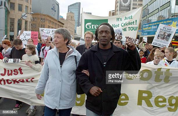 Former Zimbabwe crickter Henry Olonga walks arm in arm with human rights campaigner Judith Todd at the front of the protest march over the Black Caps...