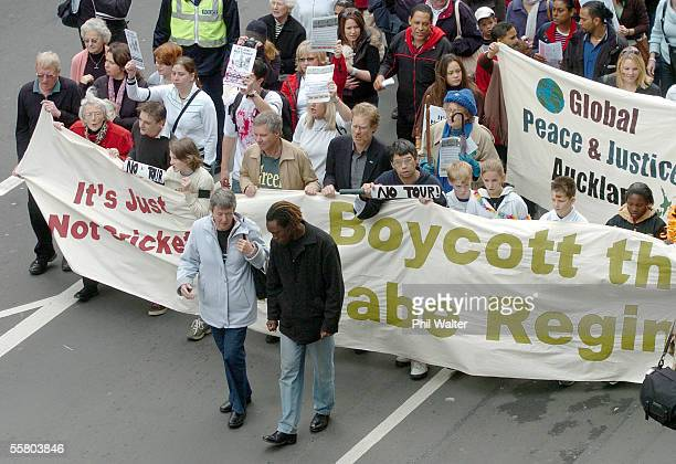Former Zimbabwe crickter Henry Olonga walks with human rights campaigner Judith Todd at the front of the protest march over the Black Caps upcoming...