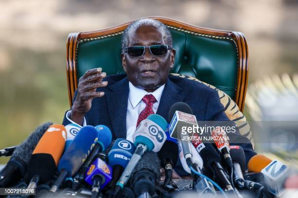 TOPSHOT Former Zimbabwean President Robert Mugabe addresses media on July 29 2018 during a surprise press conference at his residence Blue Roof in...