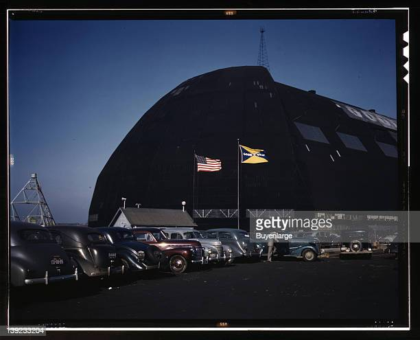Formerly an aircraft dock this huge building is now the scene of many busy shops turning out aircraft subassembly parts Goodyear Aircraft Corp Akron...