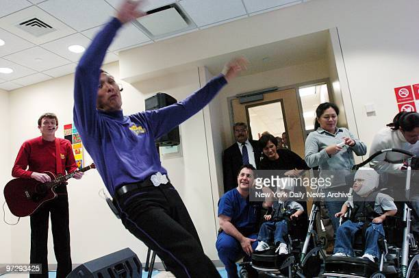 Formerly conjoined twins Clarence and Carl Aguirre enjoy a performance of The Wiggles at The Children's Hospital at Montefiore Medical Center