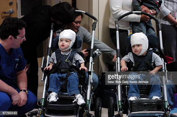 Formerly conjoined twins Clarence and Carl Aguirre enjoy a performance of The Wiggles at The Children's Hospital at Montefiore Medical Center Dr...