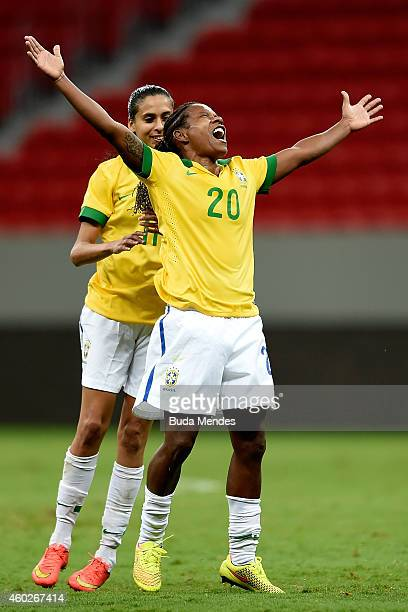 Formiga and Andressa of Brazil celebrate a scored goal against Argentina during a match between Brazil and Argentina as part of International Women's...